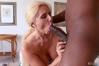 Samantha Silver enjoys letting black men plow into her sexy white hole, and