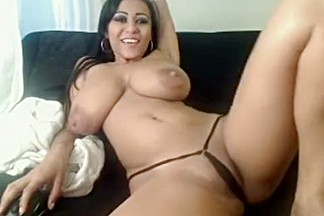 Busty brunette babe with big boobs teasing and seducing on webcam at home