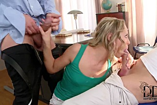 Blonde slut kneels and sucks two massive dongs