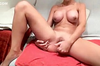 Hot busty babe teasing on live cam while fingering her creamy pussy