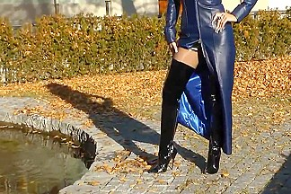 Sexy blonde lady blue leather and shiny boots