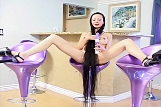 Cute Asian Plays With Purple Rabbit