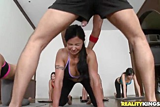 Pilates trainer is touching his girls while teaching