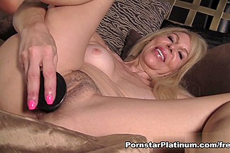 Erica Lauren in Black Dildo In Bed
