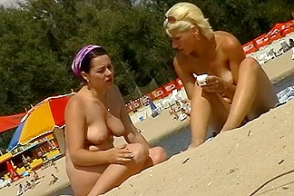Two topless girls sunbathing in front of a hidden cam