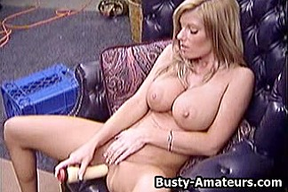 Busty Tera masturbates her pussy with huge dildo