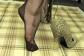 Foot tease in brown stockings 3