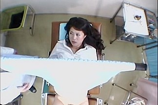 Japanese hottie exposed in a medical exam voyeur video