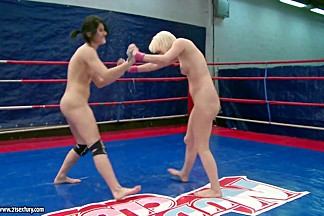 Lucy Belle playing nasty with hot chick inside the ring