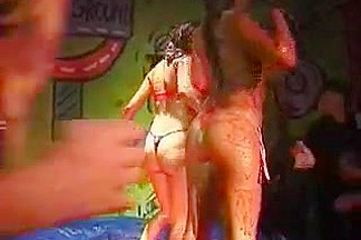 Mud fight with women stripping each other