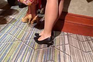 Candid sexy brunette shoeplay heels in nylons feet