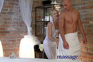 Young blonde masseuse has squirting orgasm over oiled hunk
