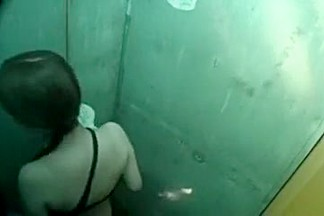 Asian cutie taking a shower gets caught on hidden cam